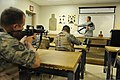 U.S. Air Force Senior Airman Nicholas Niles tells Airmen to aim their M16A2 rifles at a target in a classroom during a combat arms training and maintenance course at Barksdale Air Force Base, La., Aug. 18, 2011 110818-F-DM566-001.jpg