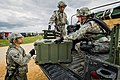 U.S. Air Force aeromedical evacuation team members unload their equipment from a Humvee during Joint Readiness Training Center (JRTC) 14-05 training at Fort Polk, La., March 14, 2014 140314-F-XL333-304.jpg
