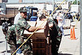 U.S. Air Force personnel from Tinker Air Force Base, Oklahoma, work to pass out bottles of water to rescue and support personnel at the explosion site of the Federal Building F-3891-SPT-95-U-026.jpg