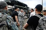 U.S. Army Maj. Rudi Lusa, center, a civil affairs officer assigned to the 2nd Brigade Combat Team, 82nd Airborne Division, briefs role players before the start of the noncombatant evacuation operation portion 130623-A-DP764-840.jpg