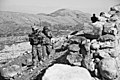 U.S. Army Sgt. 1st Class Buakai Tamu, with 4th Cavalry Regiment, 25th Infantry Division, Task Force Raider, and an Afghan Uniformed Police officer, walk on a mountain path, in the Achin district, Nangarhar 120214-A-LP603-137.jpg