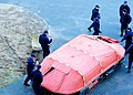 U.S. Coast Guardsmen assigned to the seagoing buoy tender USCGC Sycamore (WLB 209) and Coast Guardsmen assigned to the Northeast Regional Fisheries Training Center assess an expired 25-man life raft during 130117-G-IA651-520.jpg
