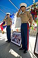 U.S. Marines render salute as they stand at attention next to a picture during the memorial service for Laura Froehlich at the Riverside National Cemetery in Riverside, Calif., Aug. 10, 2012 120810-F-YU985-095.jpg