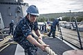 U.S. Navy Cryptologic Technician (Technical) 2nd Class Phillip Glover heaves in a line aboard the guided missile destroyer USS McCampbell (DDG 85) as the ship arrives in Saipan Jan. 21, 2014, for a scheduled 140121-N-IP531-109.jpg