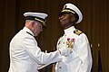 U.S. Navy Vice Adm. Matthew Nathan, Surgeon General of the Navy, presents Capt. Pius Aiyelawo, outgoing commander, U.S. Naval Hospital Okinawa Okinawa, the Legion of Merit Medal at the U.S. Naval Hospital 130718-M-DG262-033.jpg