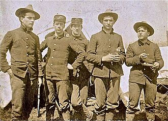 John W. Shenk - Shenk, second from left, with other U.S soldiers during the Spanish–American War
