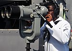 USS Rushmore sailor stands watch 121015-N-YQ852-011.jpg
