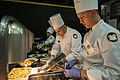 US Army Reserve Culinary Arts Team serves three-course meal to guest diners 160310-A-XN107-149.jpg