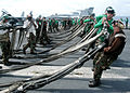 US Navy 030904-N-9742R-002 Flight deck personnel work to stow an emergency barricade.jpg