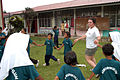 US Navy 040714-N-4104L-004 Lt.j.g. Sarah Heidt, anti-submarine warfare officer aboard USS McCampbell (DDG 85), plays a schoolyard game with Aboriginal students in Sungai Jin, Malaysia.jpg