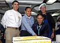 US Navy 041130-N-6363M-009 Capt. James Gigliotti, Capt. Paul Monger, Fireman Apprentice Louchelle Loretto and Fireman Apprentice Andrea Barney participate in a Native American Heritage Month cake-cutting ceremony.jpg