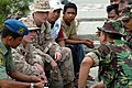 US Navy 050109-N-9885M-018 U.S. Marines Lance Cpl. Kenneth Gregoire, second from left, and Lance Cpl. Thomas Reed, talk to locals Indonesians.jpg