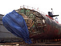 US Navy 050127-N-4658L-015 The Los Angeles-class fast-attack submarine USS San Francisco (SSN 711) in dry dock to assess damage sustained after running aground approximately 350 miles south of Guam Jan. 8, 2005.jpg