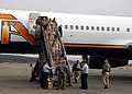 US Navy 050205-N-8497H-001 Sailors disembark their chartered airliner after returning home from a six-month deployment in Afghanistan.jpg
