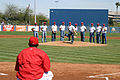 US Navy 050317-N-3271W-004 Damage Controlman 1st Class Jeff Smith, from the U.S. Navy Leap Frogs parachute team, throws out the first pitch as the rest of the Leap Frog team backs him up during a spring training baseball game.jpg
