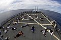 US Navy 050423-N-4309A-007 Sailors gather to conduct a Power Hour workout on the flight deck aboard the guided missile destroyer USS O'Kane (DDG 77).jpg