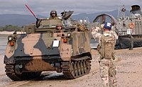 US Navy 050619-N-3455P-007 A beachmaster directs an Australian amored personnel carrier on the beach at Sabina Point during exercise Talisman Saber 2005.jpg