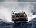 US Navy 050627-N-5046G-018 Landing Craft Air Cushion Seven Two (LCAC-72) assigned to the amphibious assault ship USS Peleliu (LHA 5) prepares to board the well deck.jpg