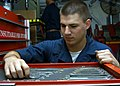 US Navy 050714-N-6495K-026 Aviation Structural Mechanic Airman Eric Campbell counts tools during inventory of a toolbox in the Aircraft Intermediate Maintenance Department.jpg
