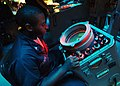 US Navy 050715-N-4374S-012 Operations Specialist 2nd Class Jabari Ettinoffe, assigned to the guided missile cruiser USS Thomas S. Gates (CG 51), tracks surface contacts from a SPA-25F Radar Repeater in the Combat Information Ce.jpg