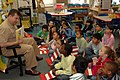 US Navy 060302-N-5387K-050 USS Kitty Hawk (CV 63) Executive Officer, Jeffrey C. Amick, reads a Dr. Seuss book to a 2nd grade class at Sullivans Elementary School.jpg