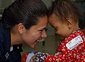 US Navy 060822-N-2832L-128 Navy Lt. Rachel Oden, of Casa Grande, Ariz., a physical therapist plays with a young girl during her first day of physical therapy for her neuromuscular control deficits.jpg