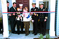 US Navy 070402-N-2492E-001 The family of Machinist's Mate 1st Class Matthew Hardman is welcomed to their new home in Forrestal Village during a ribbon cutting ceremony marking the official opening of Naval Station Great Lakes'.jpg
