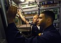 US Navy 070717-N-1598C-008 Aviation Electrician's Mate 2nd Class Curtis Meyers and Aviation Electrician's Mate 2nd Class Carlos Ramos troubleshoot an Aircraft Engine Components Test Stand in the aircraft intermediate maintenanc.jpg