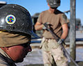 US Navy 080107-N-7367K-007 Builder 3rd Class Shawn Laborde, assigned to Naval Mobile Construction Battalion (NMCB) 1, Task Force Sierra, looks on while other Seabees continue laying concrete.jpg