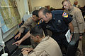 US Navy 080630-F-1689G-006 Marines assigned to Marine Medium Helicopter Training Squadron (HMMT) 164 and Marine Medium Helicopter Squadron (HMM) 268 review flight plans with Fire Chief Jim Gonzalez.jpg