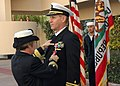 US Navy 090116-N-6326B-003 Rear Adm. Christine S. Hunter, commander, Naval Medical Center San Diego, presents the Bronze Star medal to Cmdr. Joey Swartz.jpg