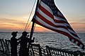 US Navy 090503-N-4124C-001 Sailors aboard the guided-missile destroyer USS Forrest Sherman (DDG 98) haul down the Ensign during evening colors at anchor off the coast of southern Florida.jpg