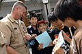 US Navy 090707-N-9818V-365 Master Chief Petty Officer of the Navy (MCPON) Rick West meets and talks with Japanese sixth grade elementary school students at Naval Air Facility Atsugi, Japan during his visit to the base.jpg