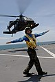 US Navy 090709-F-1333S-119 Aviation Boastswain's Mate 3rd Class Matthew Shaw directs a UH-60 Army Blackhawk helicopter.jpg