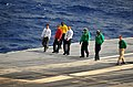 US Navy 100202-N-4774B-142 Flight deck crew members aboard the Nimitz-class aircraft carrier USS Carl Vinson (CVN 70) perform a foreign object and debris walk down before a refueling at sea.jpg