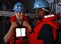 US Navy 100207-N-2218S-001 Seaman Scott Cook and Boatswain's Mate Seaman Antoine Logan prepare for a replenishment at sea aboard the amphibious assault ship USS Essex (LHD 2).jpg