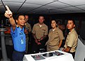 US Navy 100609-N-0995C-002 Royal Malaysian Navy Sub Lt. Syamsul Hari points out equipment on a bridge simulator to Sailors assigned to the guided-missile frigate USS Vandegrift (FFG 48).jpg