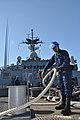 US Navy 100829-N-7293M-061 Navy Boatswain's Mate 3rd Class Michael Ford stows mooring lines on the focsle of the amphibious transport dock ship USS Ponce (LPD 15).jpg