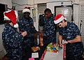 US Navy 101215-N-5620H-035 Sailors ork together to wrap donated gifts for struggling Sailors aboard USS Frank Cable (AS 40).jpg