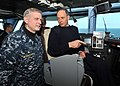 US Navy 110204-N-0569K-003 Capt. Dee L. Mewbourne speaks with French navy Rear Adm. (Upper Half) Xavier Magne on the bridge aboard USS Enterprise (.jpg