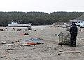 US Navy 110314-N-MU720-012 A Sailor assigned to Naval Air Facility Misawa (NAFM) hauls debris during a cleanup effort at the Misawa Fishing Port.jpg