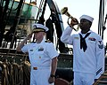US Navy 110911-N-SH953-219 Cmdr. Matthew Bonner, commanding officer of USS Constitution, renders honors as Yeoman 1st Class Mbanefo Ofodile plays T.jpg