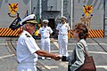 US Navy 111001-N-ZZ999-636 Cmdr. Donald Foss, commanding officer of the guided-missile frigate USS Ford (FFG 54), greets Jennifer A. McIntyre, cons.jpg