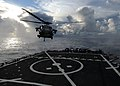 US Navy 111020-N-UE250-316 An SH-60 Sea Hawk helicopter lands on the flight deck of the forward deployed Arleigh Burke-class guided-missile destroy.jpg