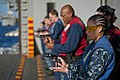 US Navy 111129-N-DX615-318 Aviation Boatswain's Mate 3rd Class Shante Moore reloads a 9mm pistol during a small arms qualification aboard the multi.jpg
