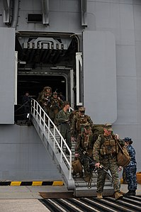 US Navy 111212-M-CR943-139 Marines serving with the 11th Marine Expeditionary Unit (11th MEU) depart the amphibious assault ship USS Makin Island (.jpg