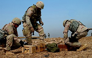 Camp Al-Saqr - Members of a U.S. Air Force explosive ordnance disposal team unpack C-4 explosives, Oct. 16, 2006. The explosives will be used to detonate a cache of unexploded ordnance recovered from a blast area on Forward Operating Base Falcon, Iraq, following a recent mortar attack. The airmen are assigned to the 447th Expeditionary Civil Engineering Squadron.