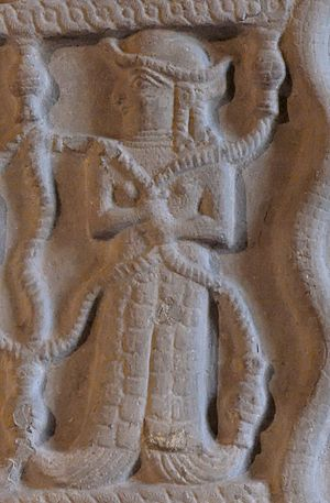 Elam - Relief resembles a fish tailed woman holding snakes