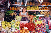 Salvadoran woman at a food stall