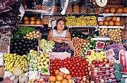 Salvadoran woman at a food stall.